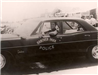 1969 Photo of Retired Lieutenant Raoul Hill Driving a 1966 Pontiac Catalina